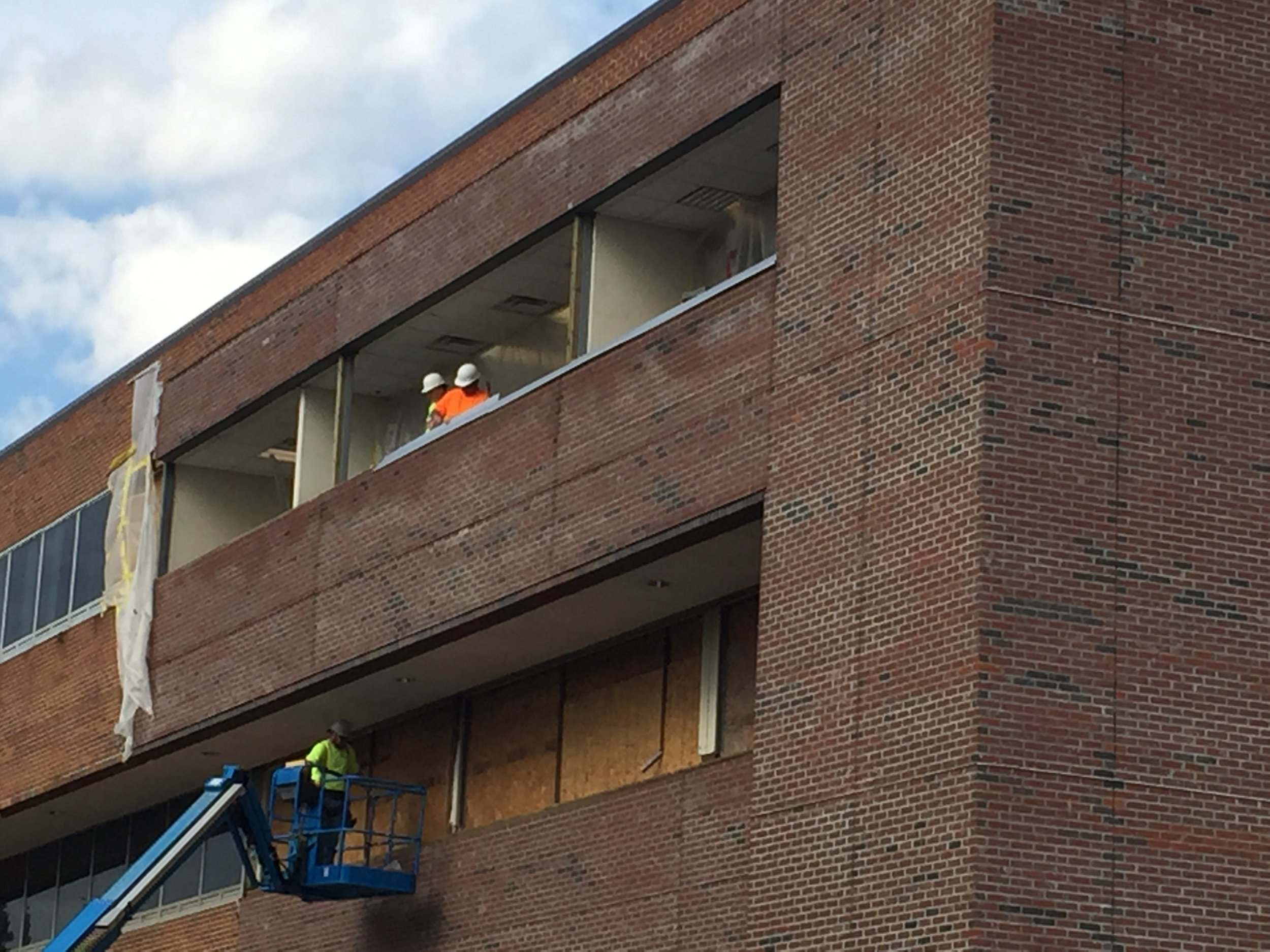 Staging for the installation of new windows. The new brick appears on the right.