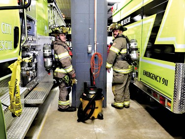 Firefighters in full gear having difficulty negotiating travel in the existing fire station.  Photo from the Tri-City Times 2018-08-01