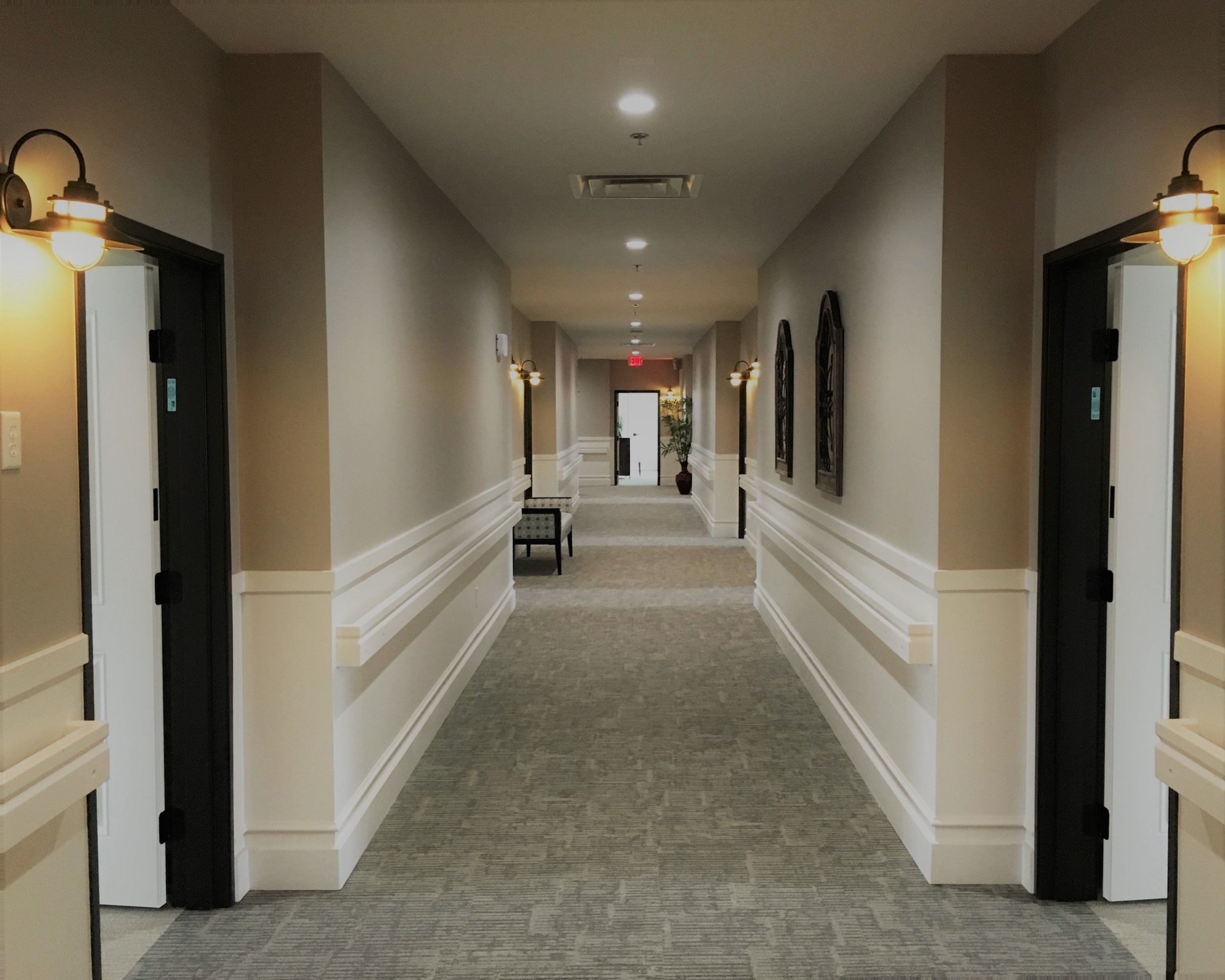 Smartly appointed colors and fixtures create comfortable walkways to residents' rooms.