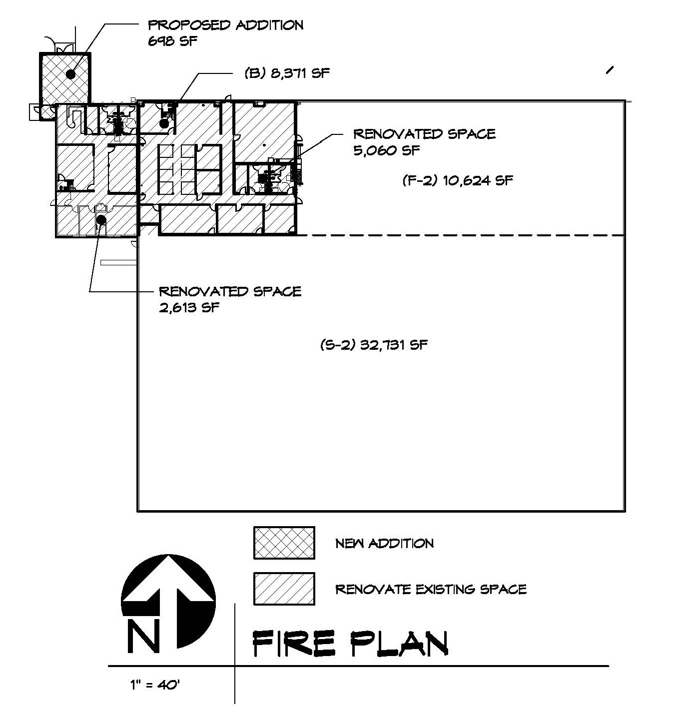 The floor plan of the existing warehouse facility showing areas to be renovated and the new entry addition.