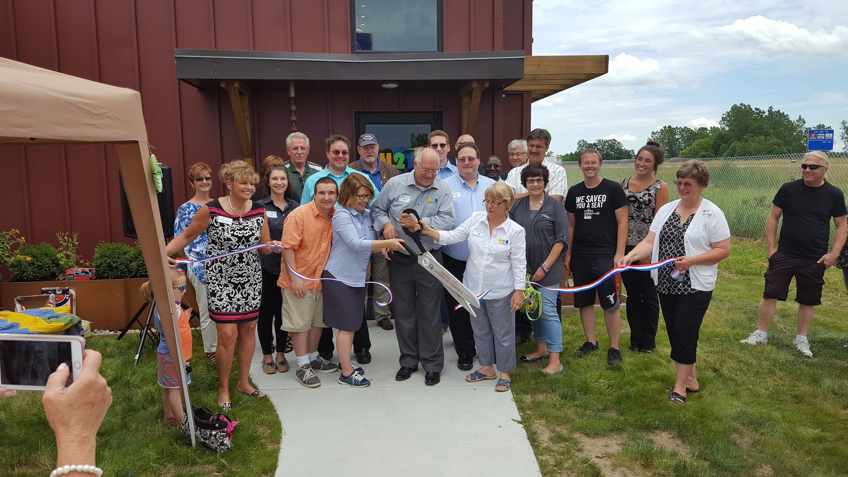 Friends, family, and local dignitaries help celebrate the grand opening of our new office in Davison.