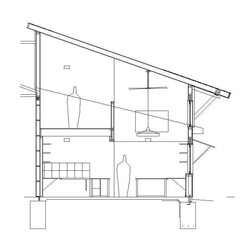 A section cut through the office shows the loft storage space above the work stations. Every attempt to maximize space and introduce design elements was considered during the design process.