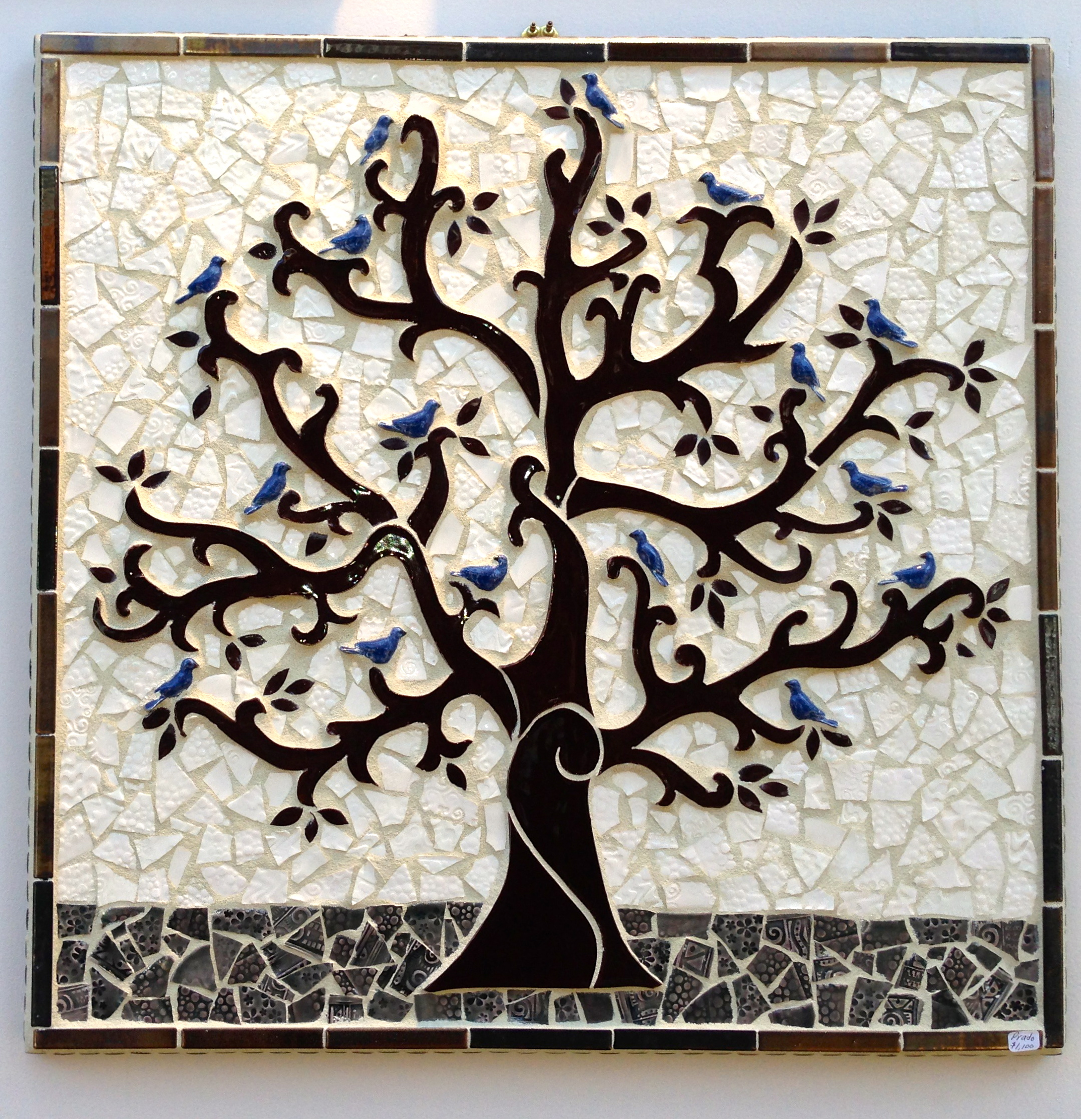 "Resting Place   25"" x 25"" features a resting flock of blue birds in a tree of life with richly textures background tiles framed in antique golden stone."