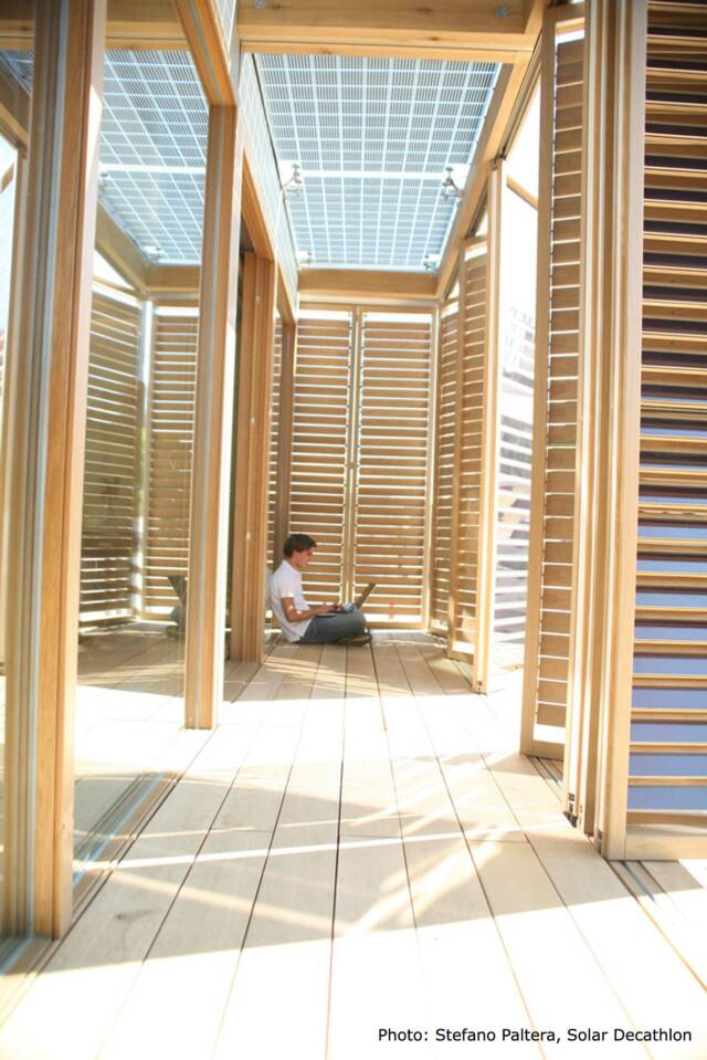 Passive house breezeway with louvre shutter doors