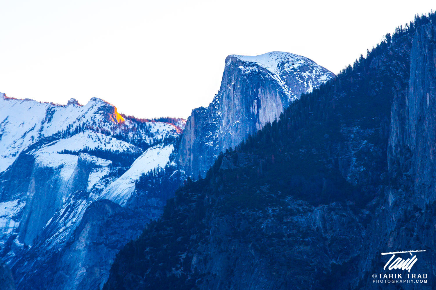 Half Dome at sunrise with the first rays of the day striking Clouds Rest to the east.