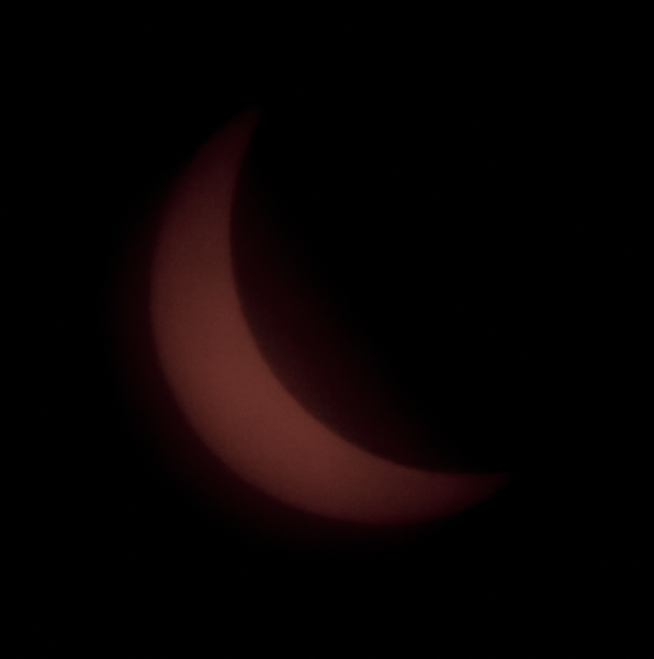 Fuzzy image of the sun due to heavy clouds in the region of Columbia, Missouri. FYI - the sun appears orange in these images due to the darkness of the solar filters used on the camera lens.