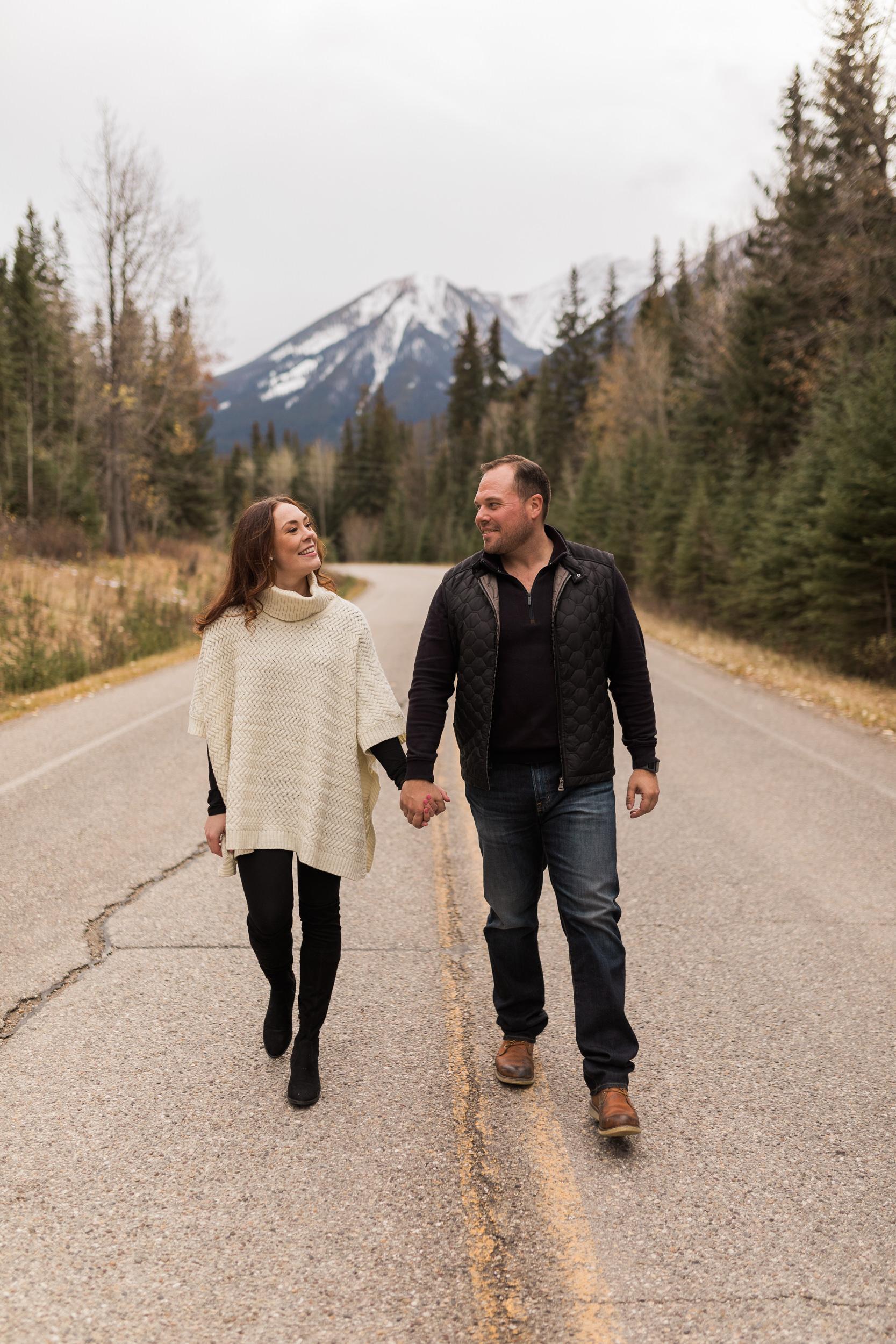 Adventurous couple engagement wandering around Banff