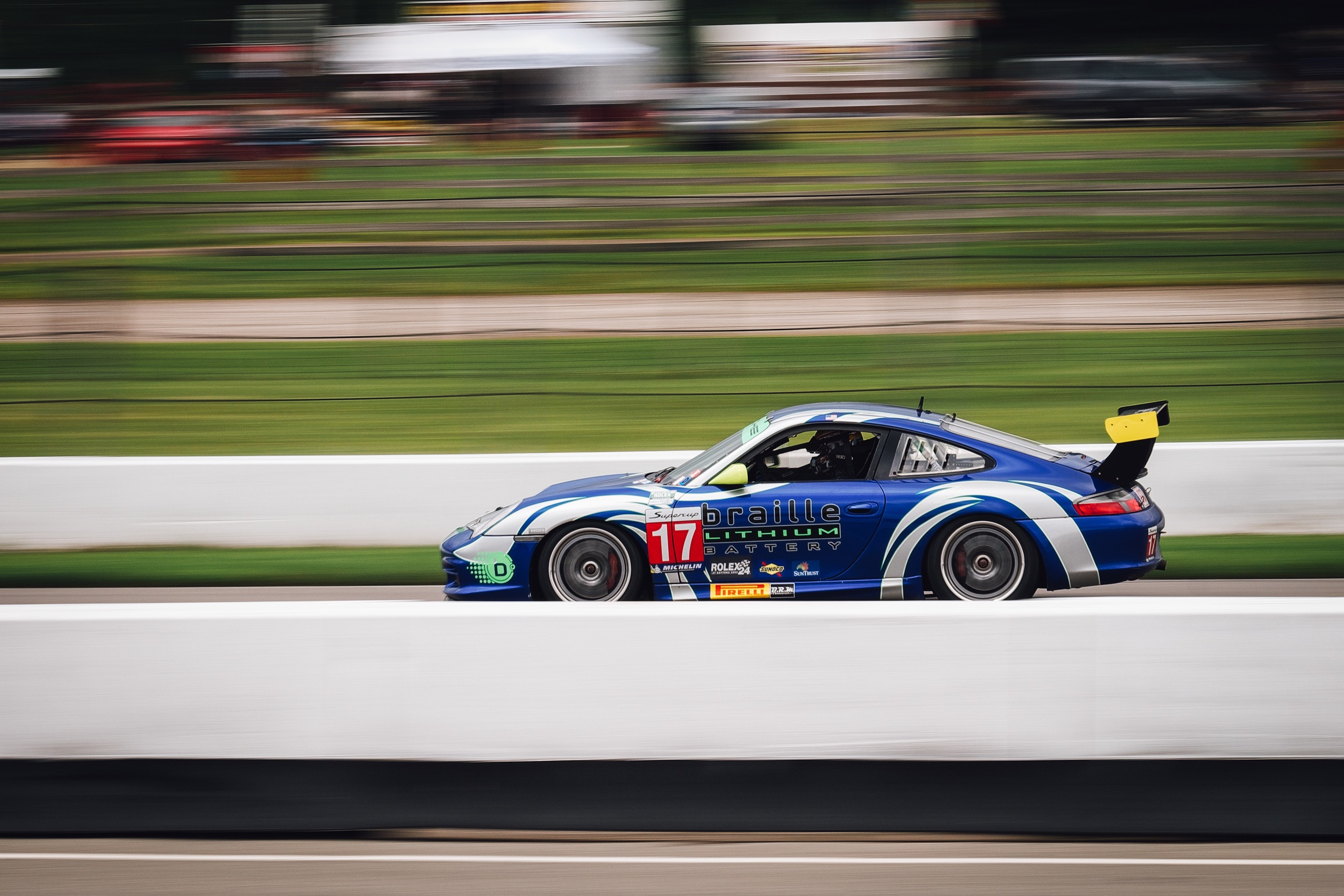Screaming down the front straight into turn 1.  Gear & Specs: Fuji X-T1 - Fujinon XF 50-140mm F2.8 R LM OIS WR - 1/60 f14ISO 200