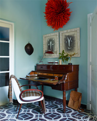 """Home of Samuel and Caitlin Dowe-Sandes in Marrakech.  """" An   1820 Cuban desk from a Paris flea market and a French Art Deco armchair in the study; the drawings by Roger Sandes were gifts from the artist, and the feather headdress is from Cameroon.""""  Elle Decor"""