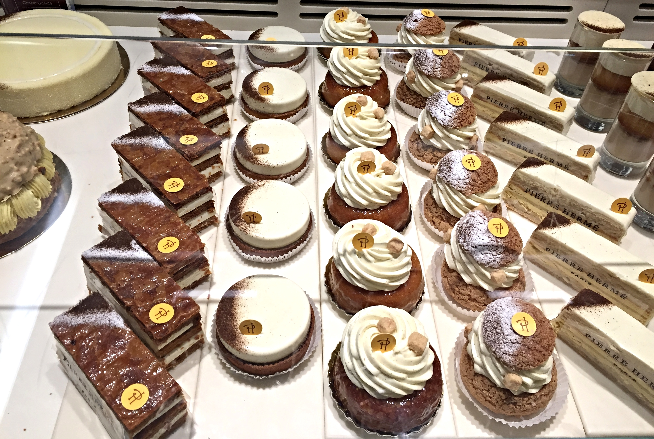 A sample of Pierre Hermé's confections. Do you see the round white tart speckled with vanilla bean second from the left? That's his famous tart infiniment vanille.