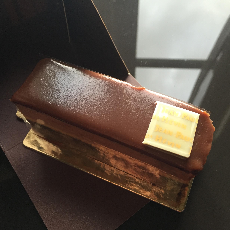 The Bergamote: a crisp base layered with dark chocolate ganache, chocolate cake, bergamot orange cream, Earl Grey milk chocolate and finished with a milk chocolate glaze