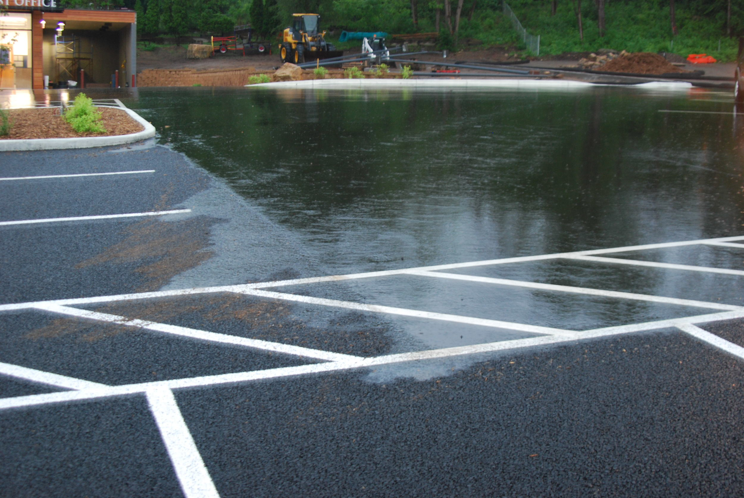 Porous Pavement in action during a rain at Trinity Lutheran in Stillwater, MN.