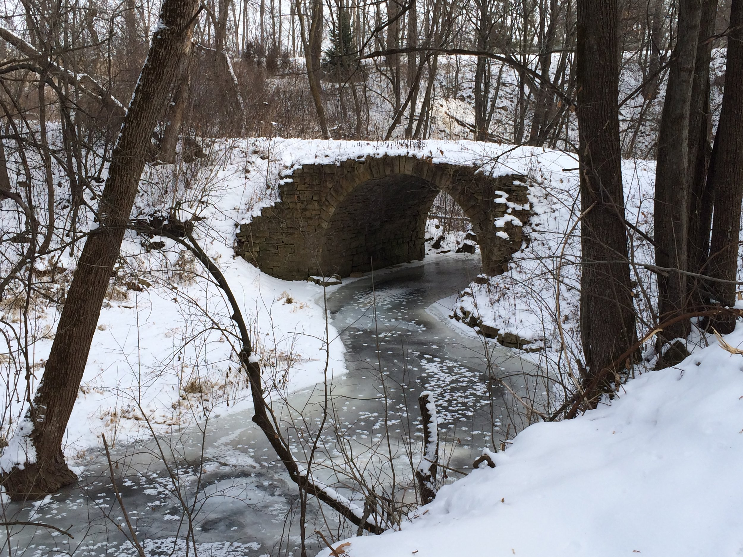 A frozen Brown's Creek at the Stone ARch Bridge.JPG
