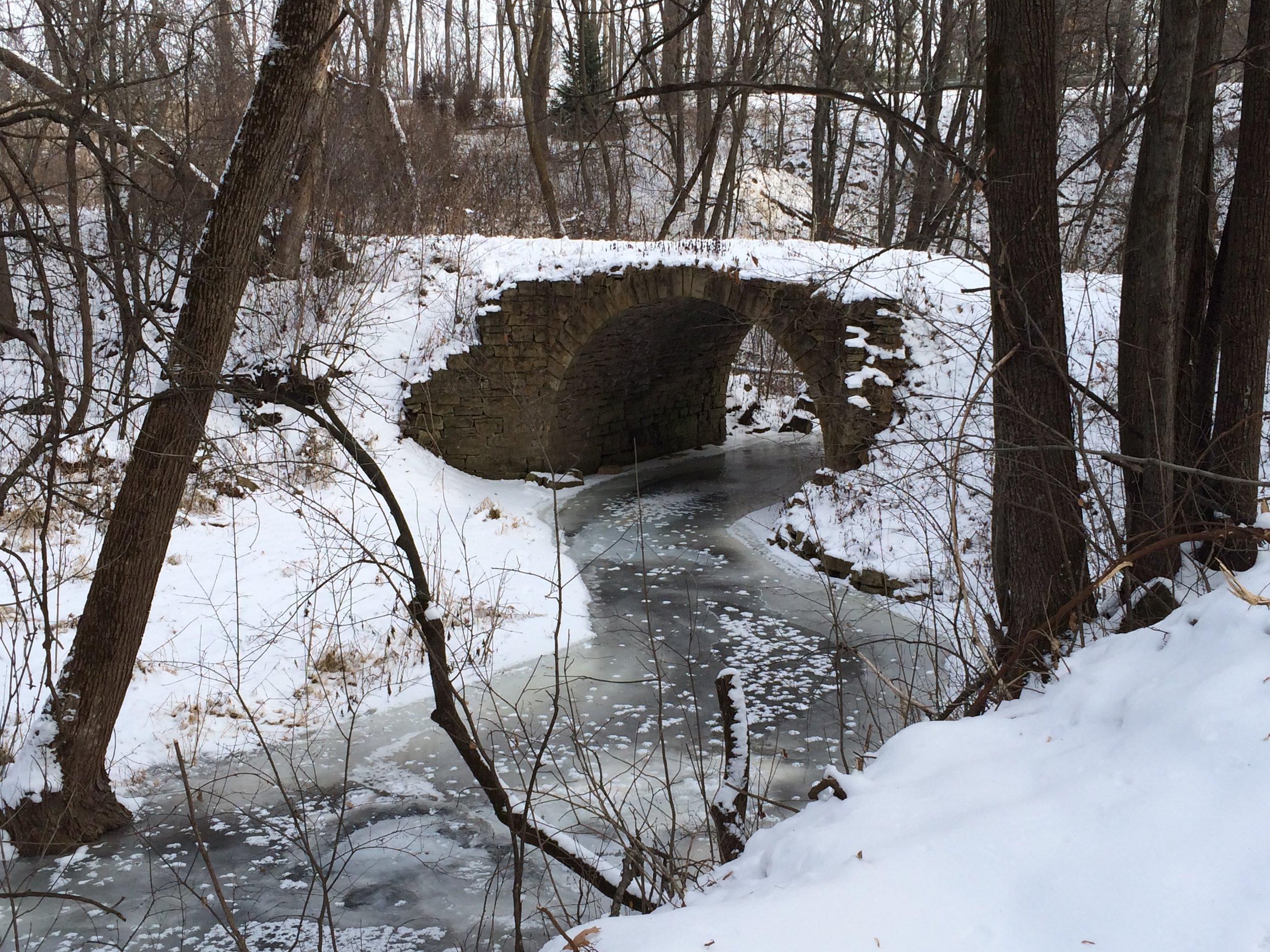 A frozen Brown's Creek at the Stone ARch Bridge.JPG