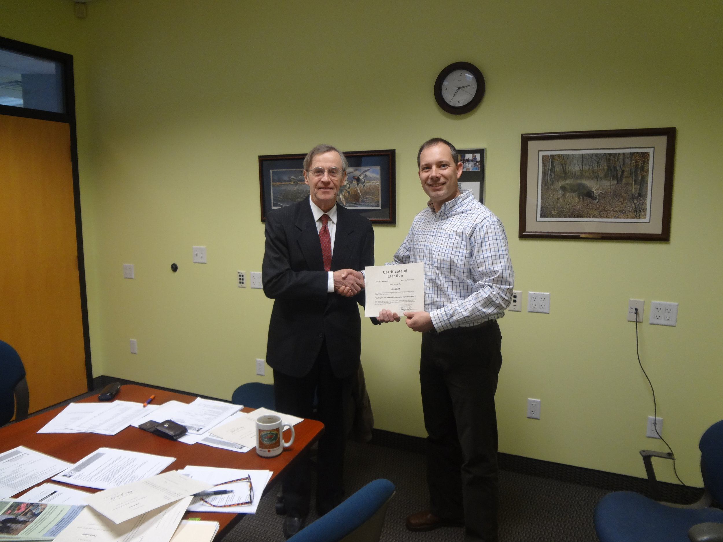 John Rheinberger is swearing in Jim Levitt after his re-election to the WCD Board this past fall.