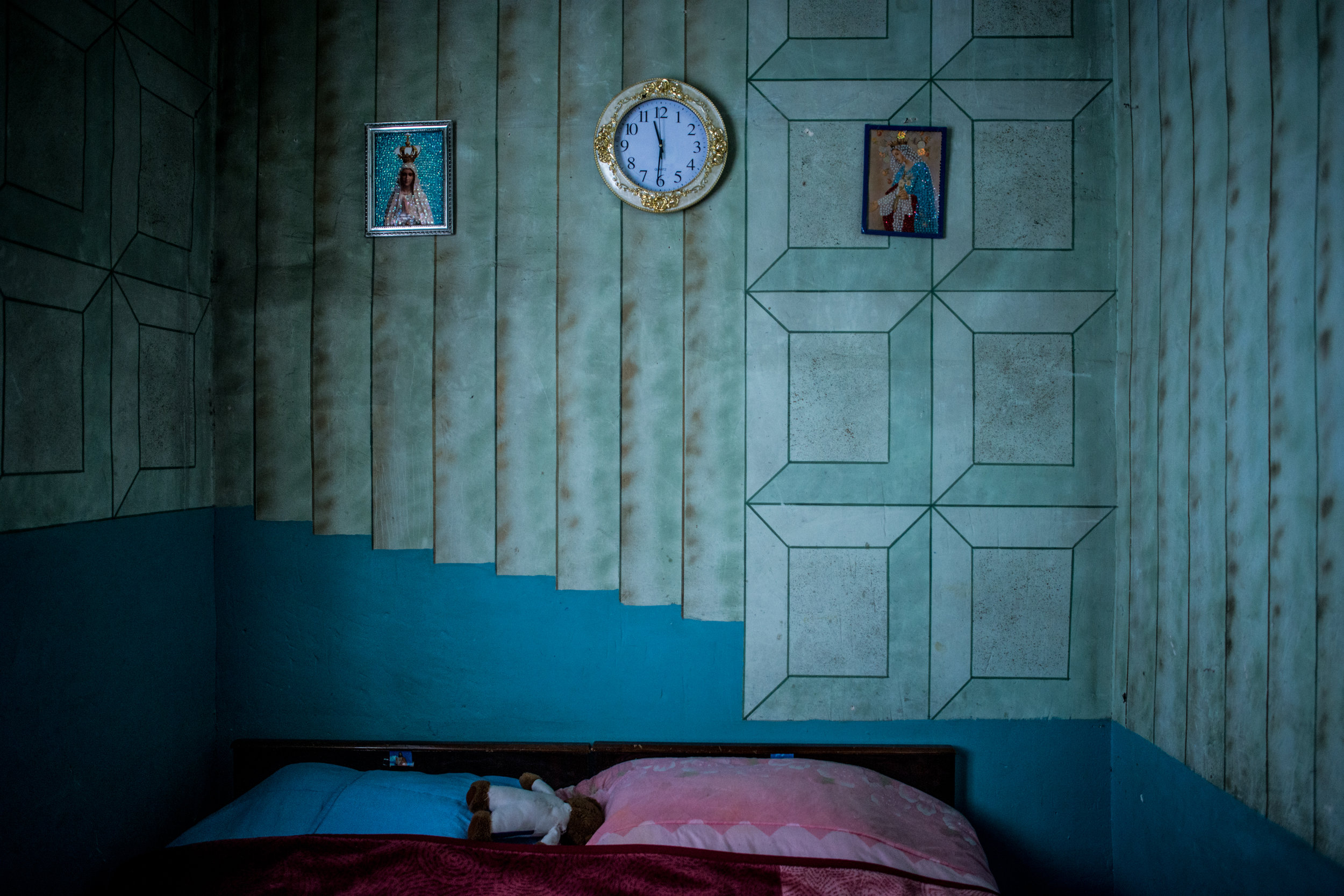 The bedroom of the family of Manush Moses, 41, and Soghomon Amseian, 48, who fled their home in Syria's eastern city of Deir Ezzor in 2013. The family moved to Qamishli for two years, and then moved to Armenia in 2015. Before the war disturbed their lives, Soghomon owned a photo studio in Deir Ezzor, which had been the family business for generations. Soghomon does not have a full time job, he works on demand assembling furniture. Manush works as a cook in a kindergarten where they also take their youngest son. The hardships are making the family rethink their stay in Armenia, and possibly move to Lebanon or any other country with better economy.