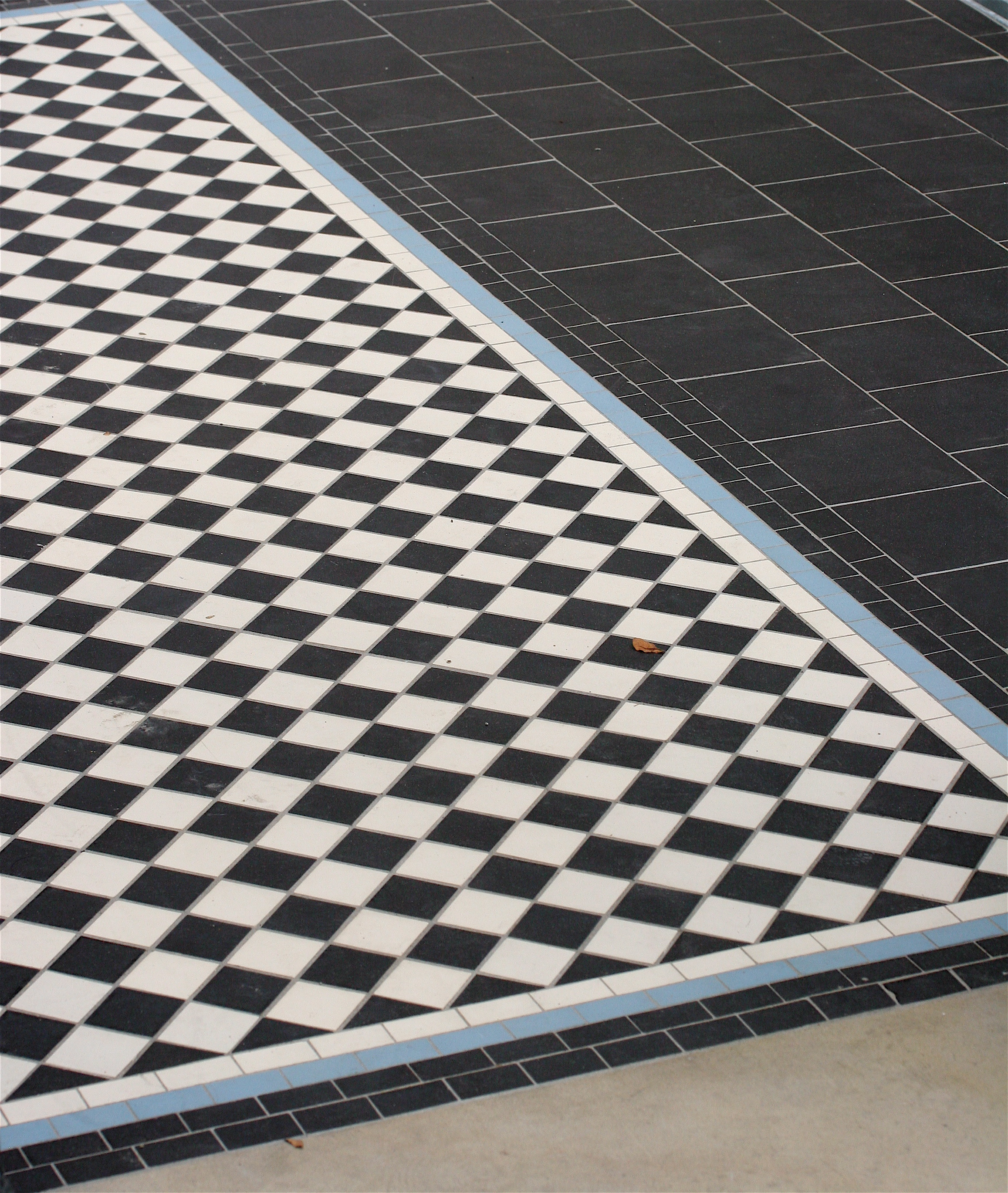 Black and white victorian tiled path with a four line border