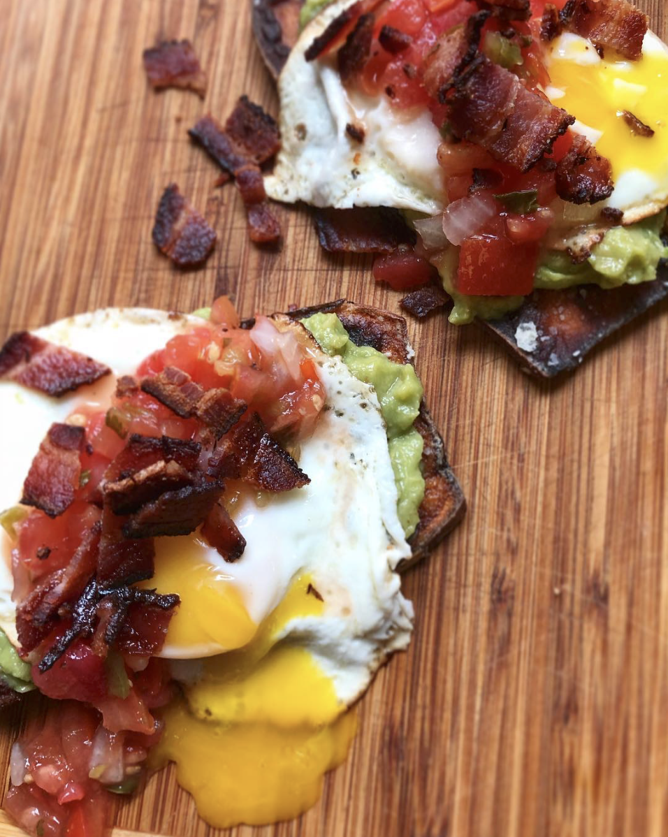 Alexis of  Paleo Rookie  makes a killer sweet potato toast topped with a runny egg, avocado, pico, and Jalapeño Naked Bacon!