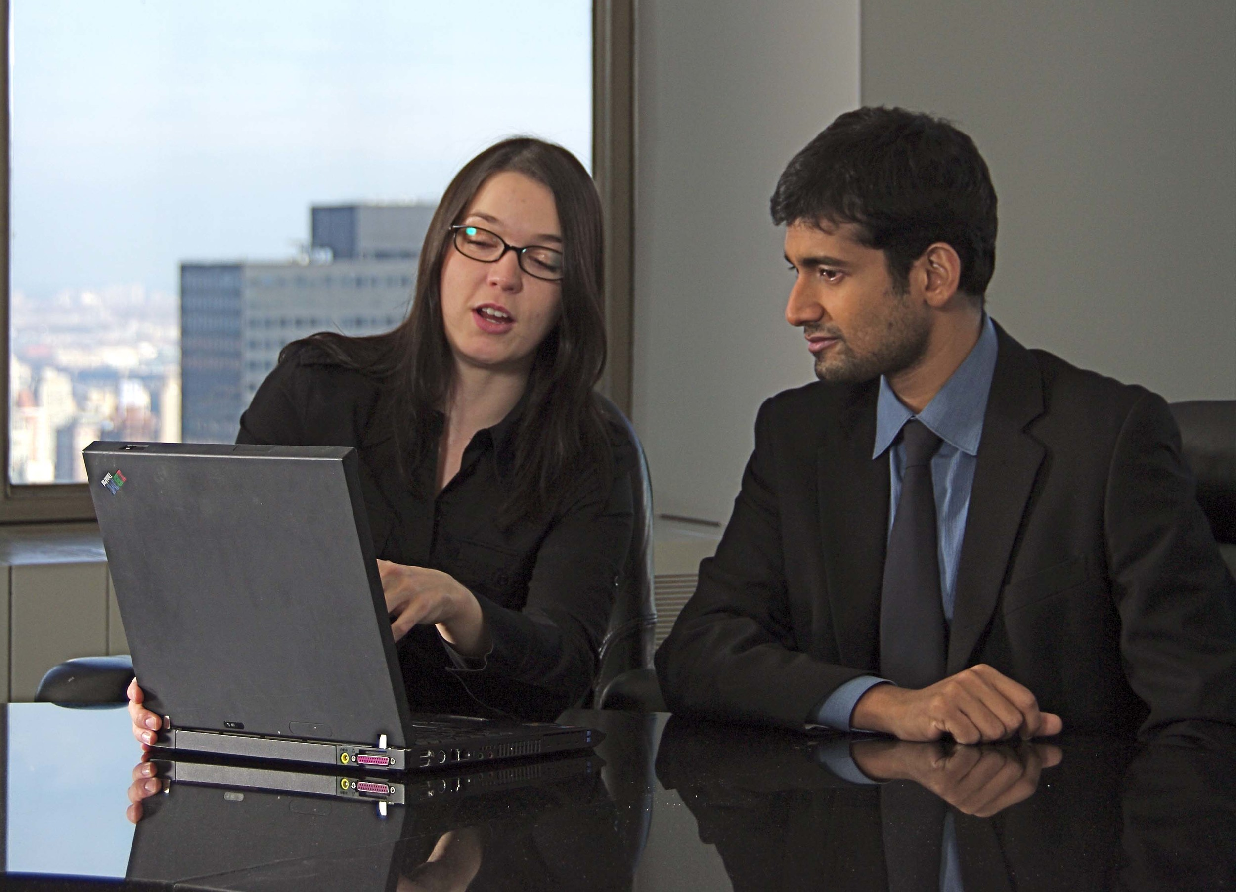 Two people looking at computer.jpg