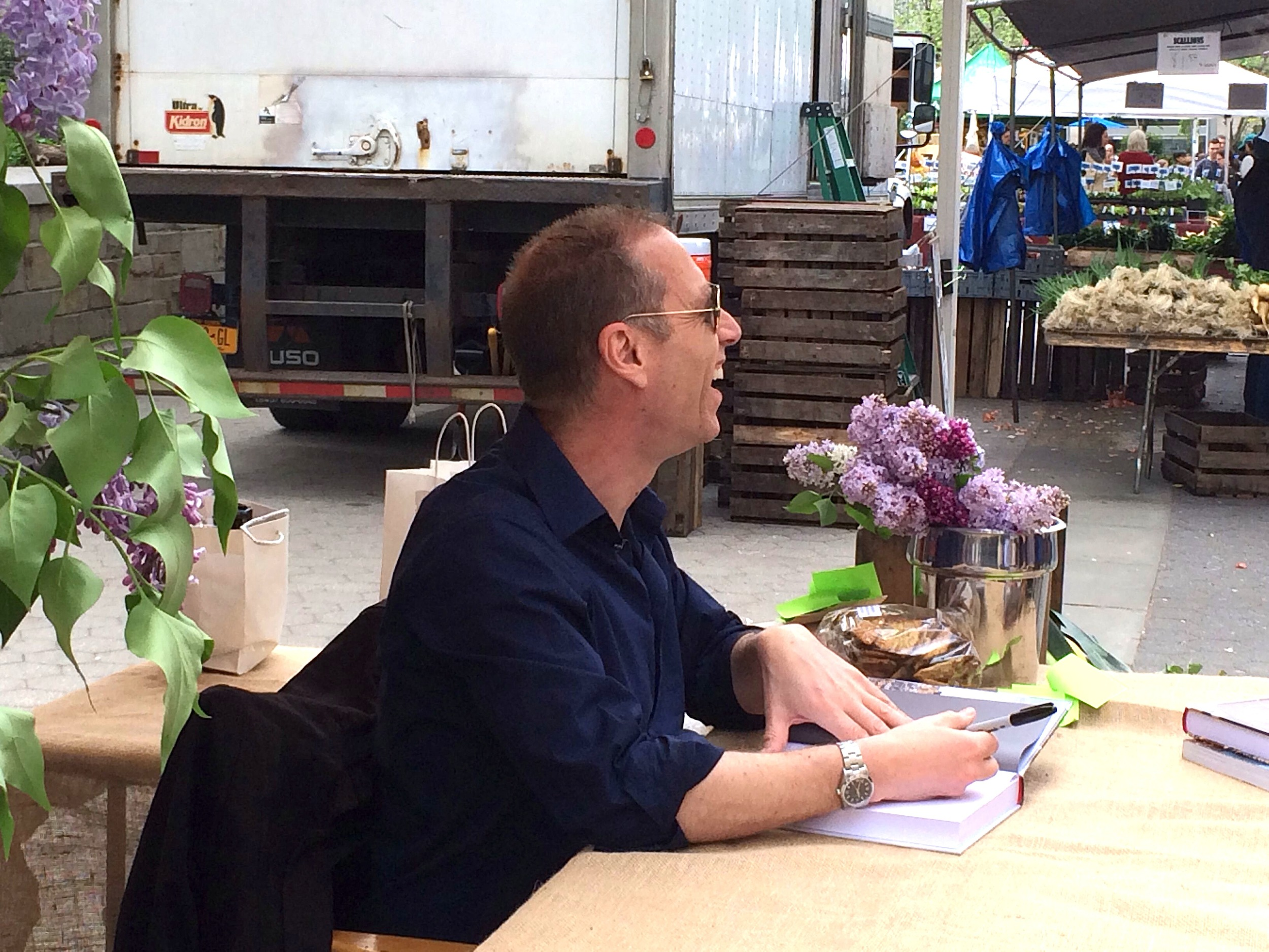 "David Lebovitz  at the  Union Square Greenmarket  in NYC, signing ""My Paris Kitchen"", his latest cookbook."