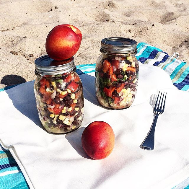 Blue sunny sky, a gentle breeze, perfect water temperature, sweet time with kiddo, and a little simple wastefree #meatlessmonday #picnic ( #marketfresh salad with fresh corn, avocado, black beans, lettuce, red pepper, red onion, herbs, cumin, lime and oo ). Grateful for this #beachside #laborday 💙🌊☀️ #grateful