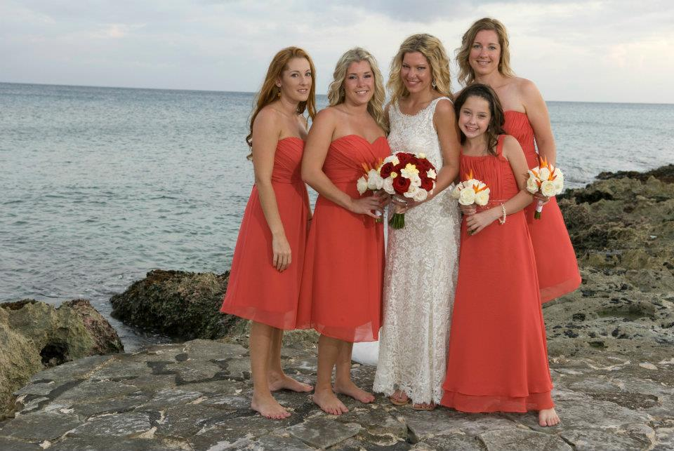 My beautiful sisters and my wonderful niece at my destination wedding in Mexico. Not so great floral! The weather wasn't great either. We had a minor hurricane...only a Bride's worst nightmare but that's another story!