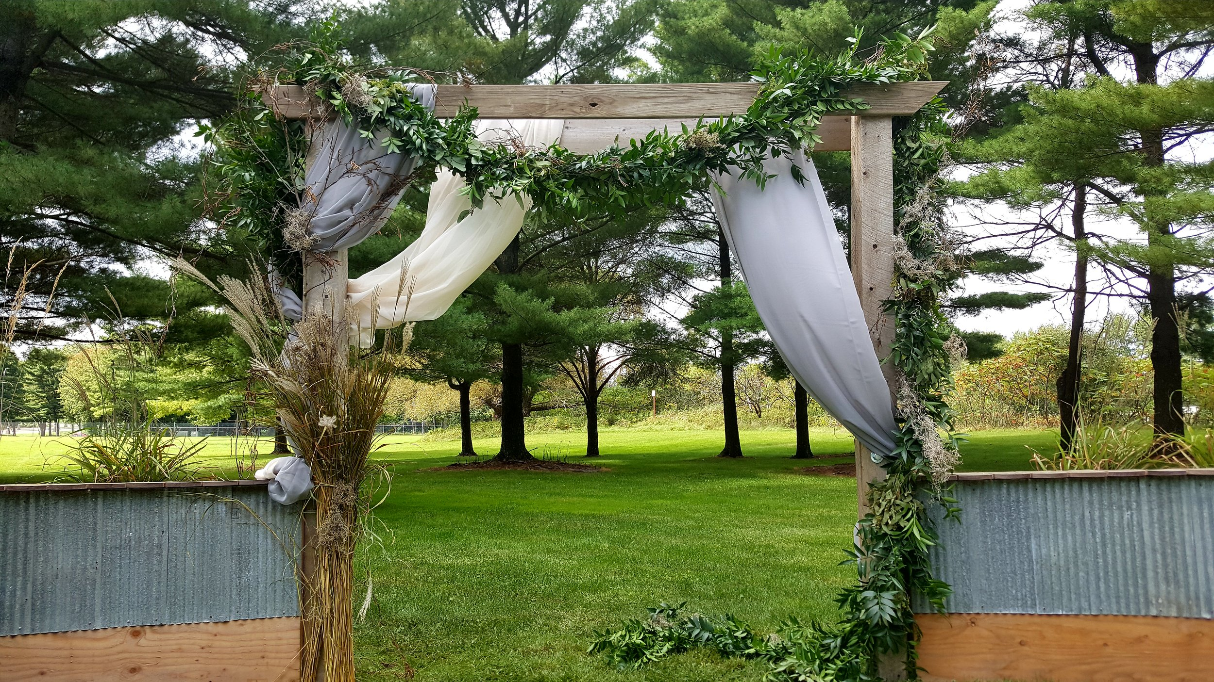 Wedding Arbor with fabric and garland
