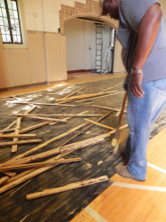 One of the first steps in renovating the Activity Center (aka Gymnasium) is to rip out the oldflooring.