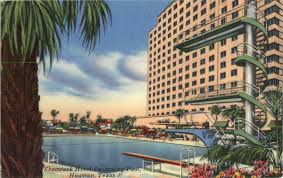 Postcard image of the legendary Shamrock Hotel and swimming pool, site of water ski shows and more. Now the site of the Texas A&M University Institute of Biosciences and Technology.