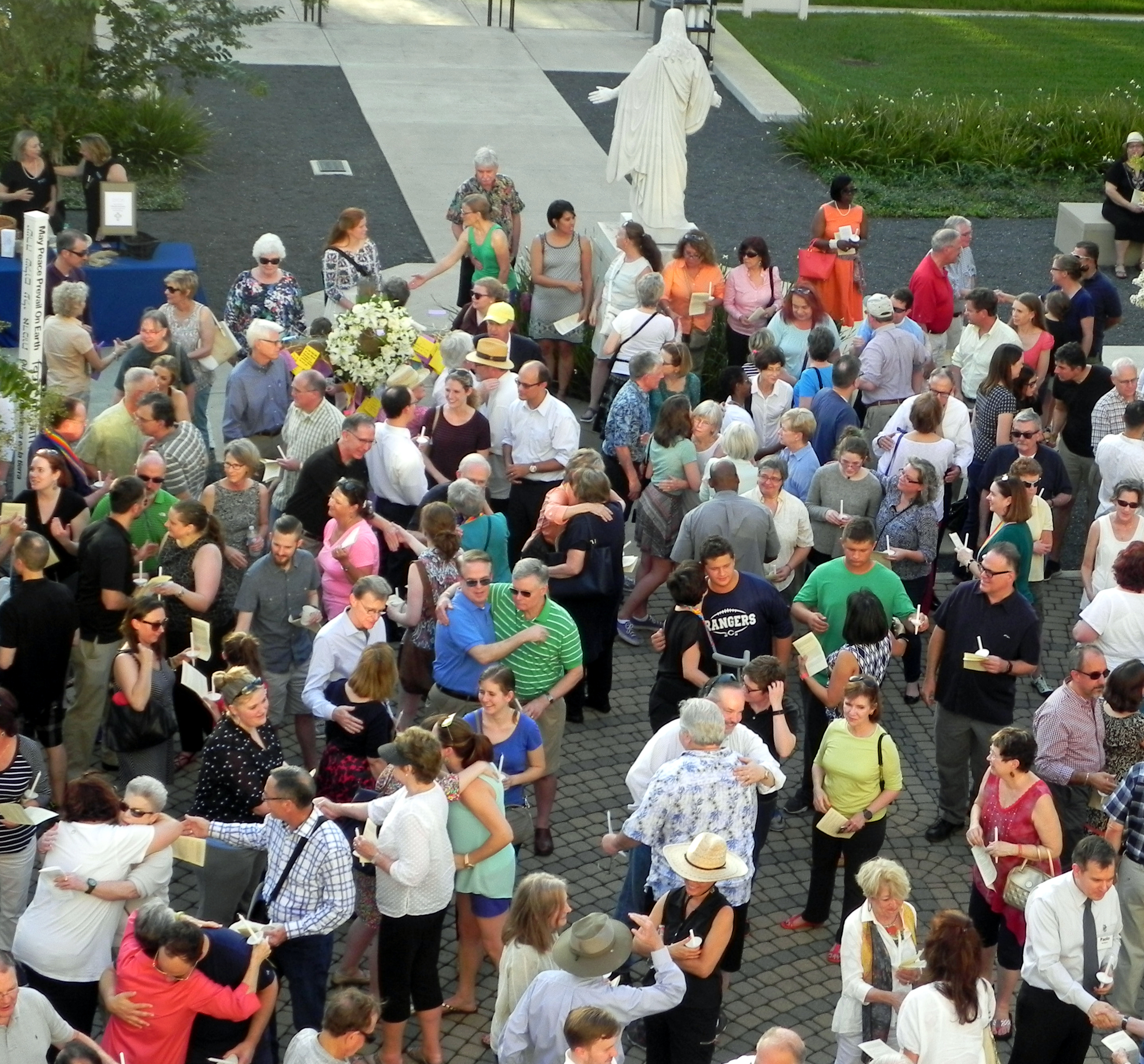 Behind the outstretched, welcoming arms of Jesus, worshipers of many congregations pass the peace at the June 15  Prayer Vigil of Lament and Hope  on St. Paul's Labyrinth.