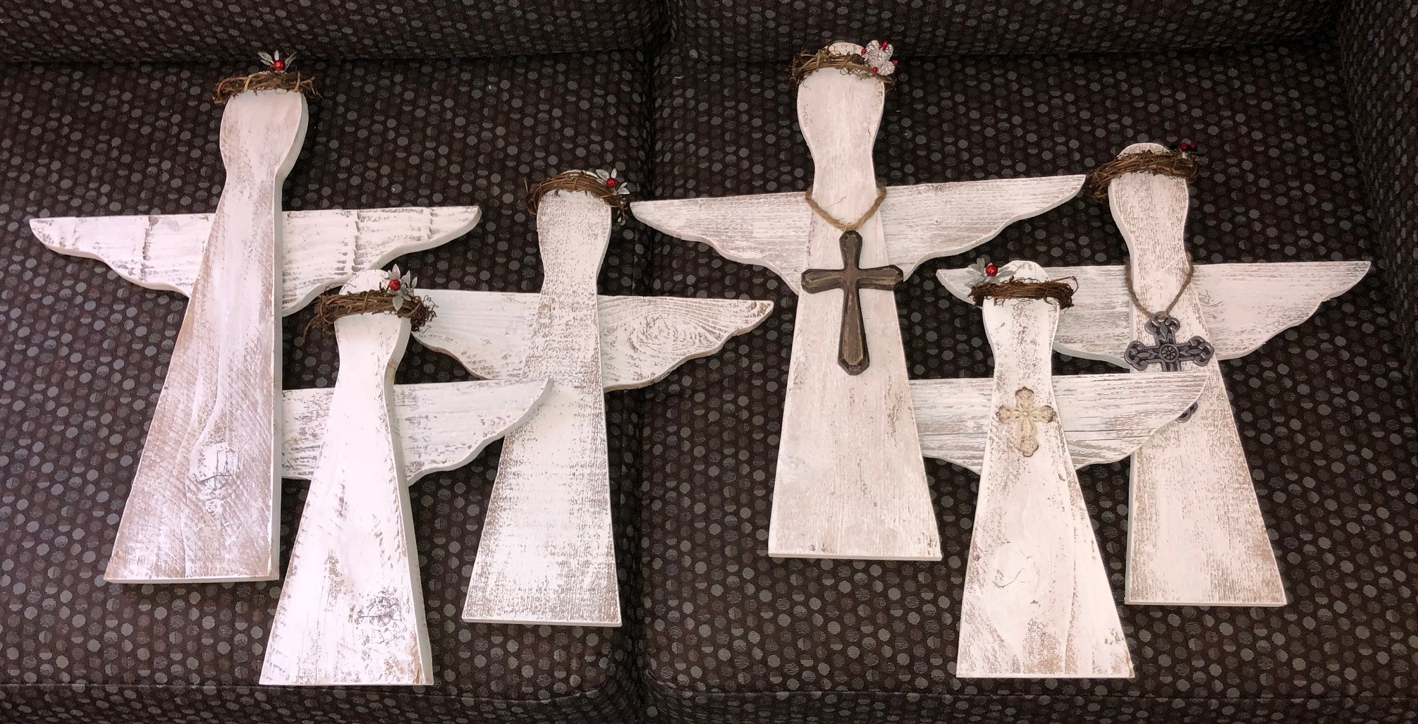 Angels, lovingly hand-crafted by St. Paul's Youth from reclaimed wood.