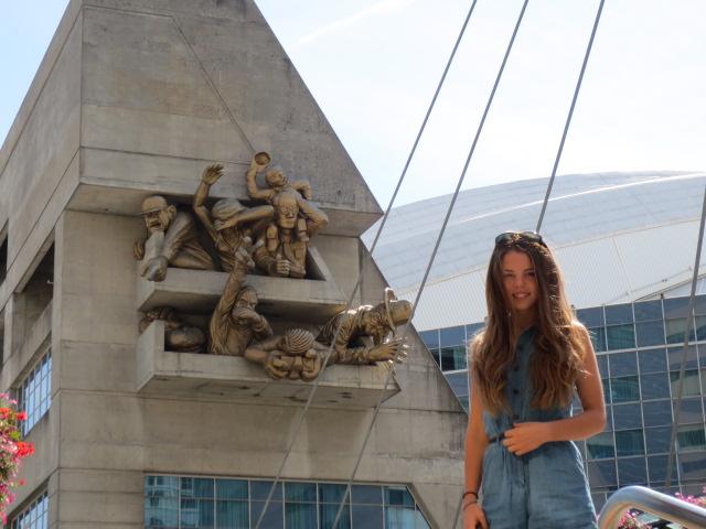 Dora beside a special sculpture