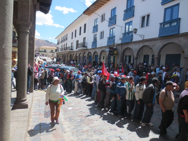 People, mainly men, were marching in to the square