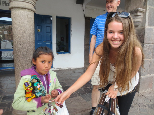 Dora buying lama keychains from a beautiful little girl