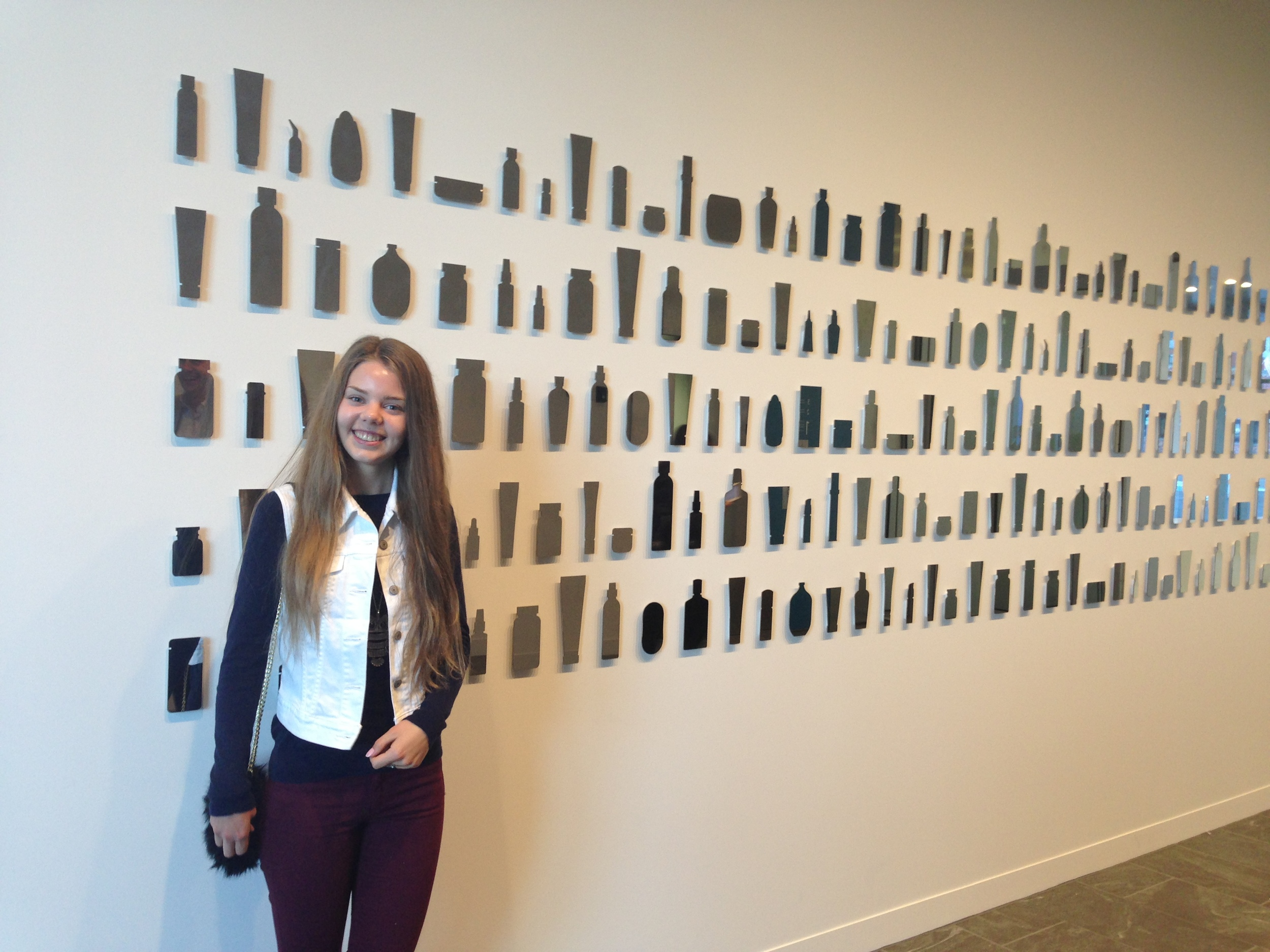 "Dora in front of ""product mirrors"" at the new Innovation Center in Provo"