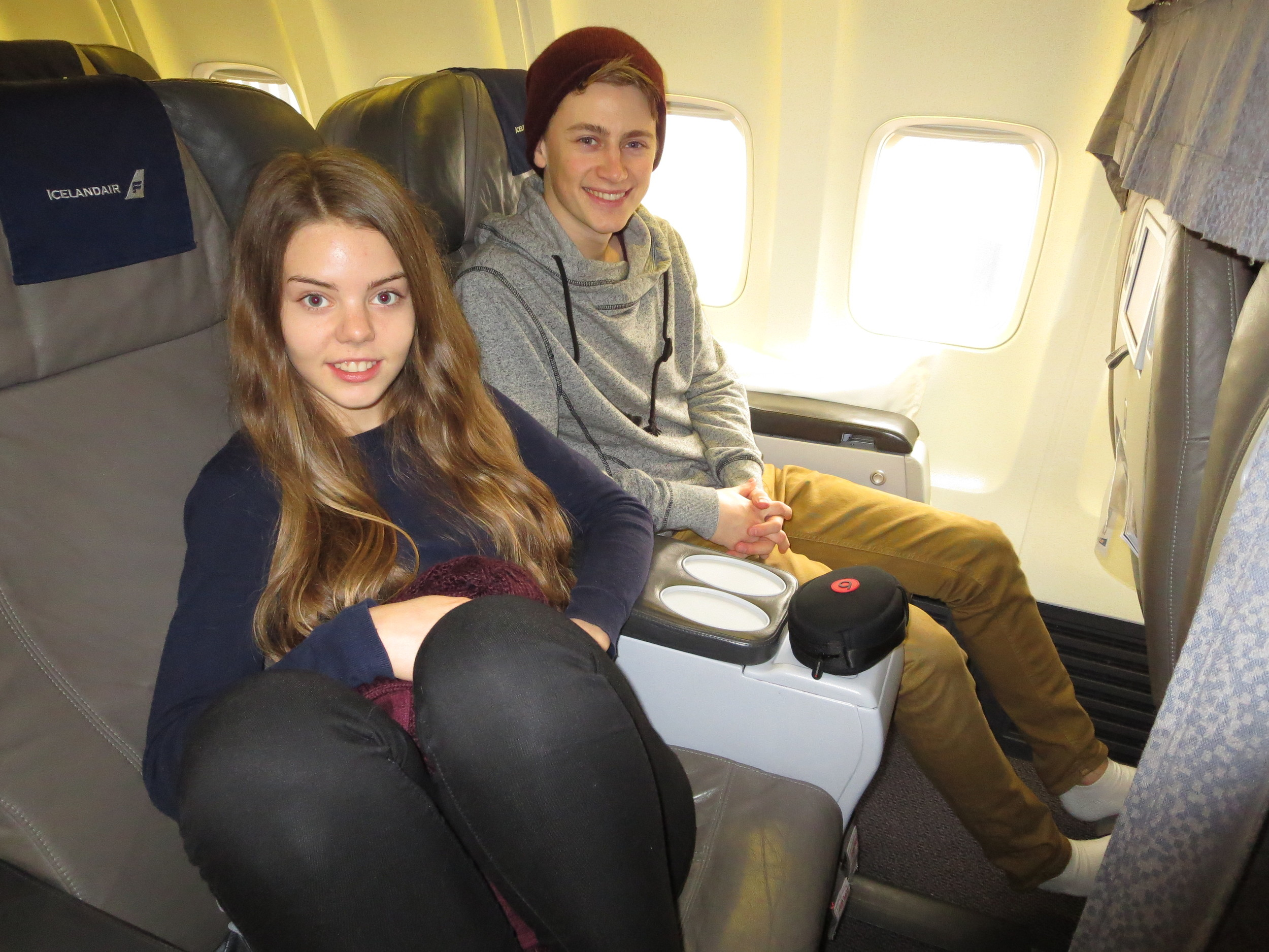 Dora and Atli enjoying their very comfy flight home