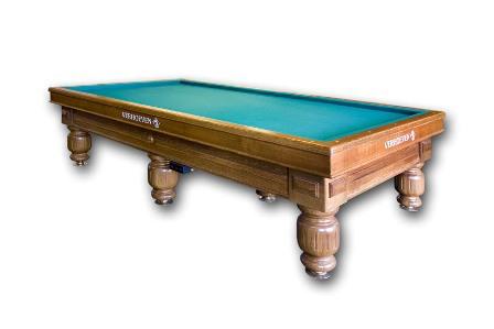 Leopold III   Met banden in verstek volledig massief, dubbel zijdelings geschroefd. Lei ééndelig op de tafel van 2.10 m en 2.30 m, driedelig op de tafels van 2.10 m, 2.30 m en 2.84 m. Deze biljarttafel heeft een dubbel frame met eiken afwerking en verwarming met elektronische digitale thermostaat. Voor de 'final finishing touch' van de banden zorgt de houtsoort eik. Afmetingen:6 regelpoten: 2.10 m x 1.05 m en 2.30 m x 1.15 m.       8 regelpoten: 2.84 m x 1.42 m.