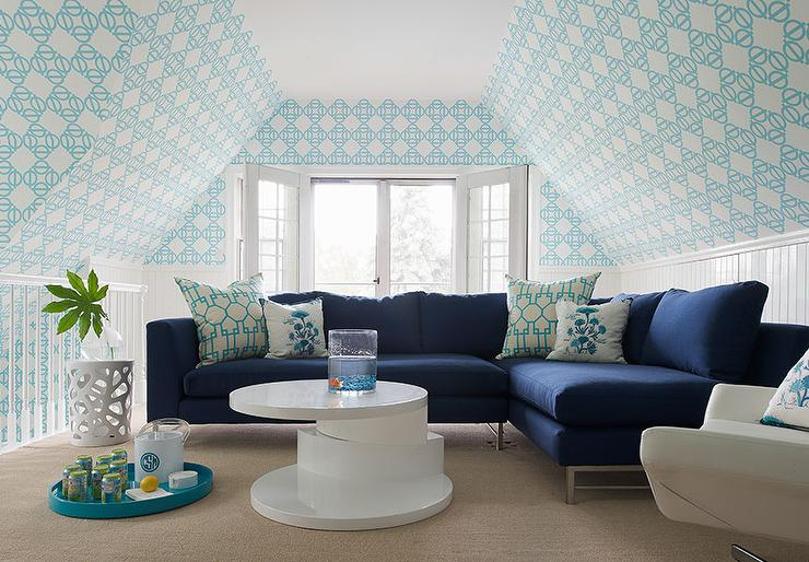 navy-sectional-turquoise-pillows-beadboard-wall-trim.jpg