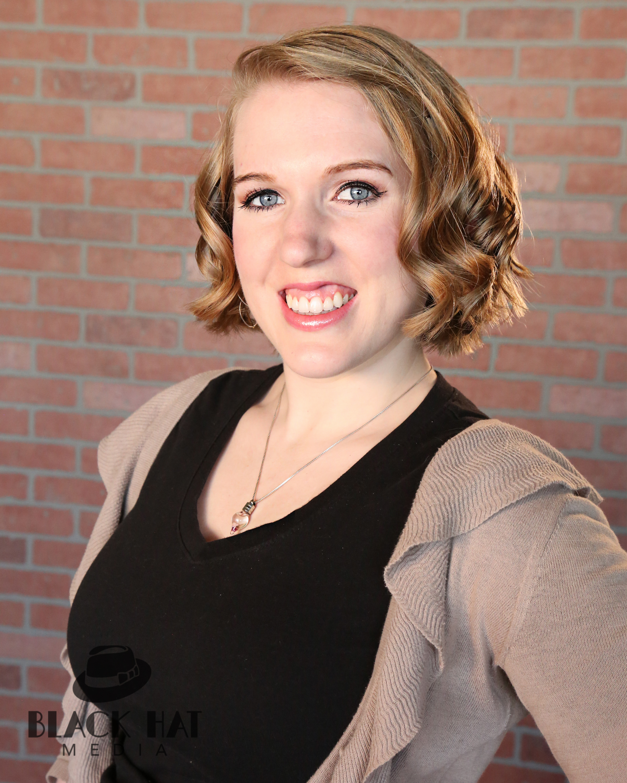 Emily Curly Smiley Headshot.jpg