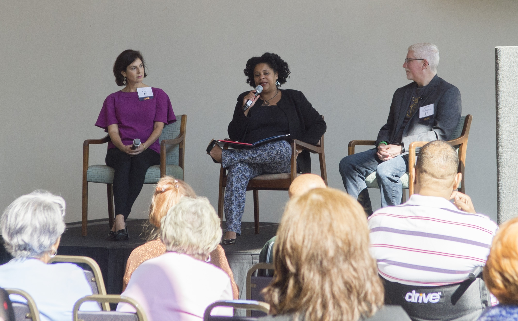Dr. Karen M.Winkfield,MD, PhD,moderates a panel discussion with Dara Kurtz and Garth Callaghan, September 2017