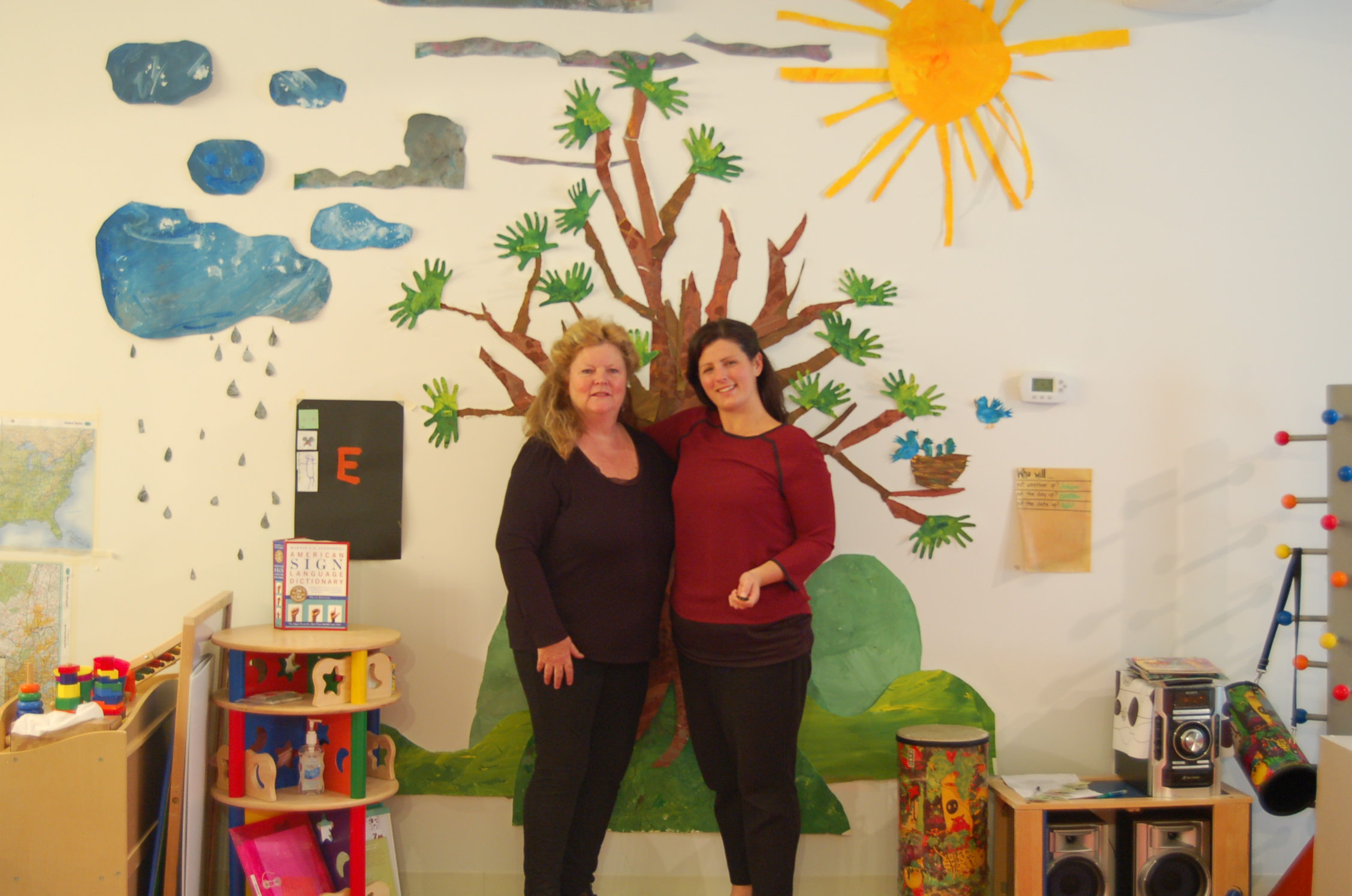 Heather and Katy in front of the Eric Carle mural that the students made.