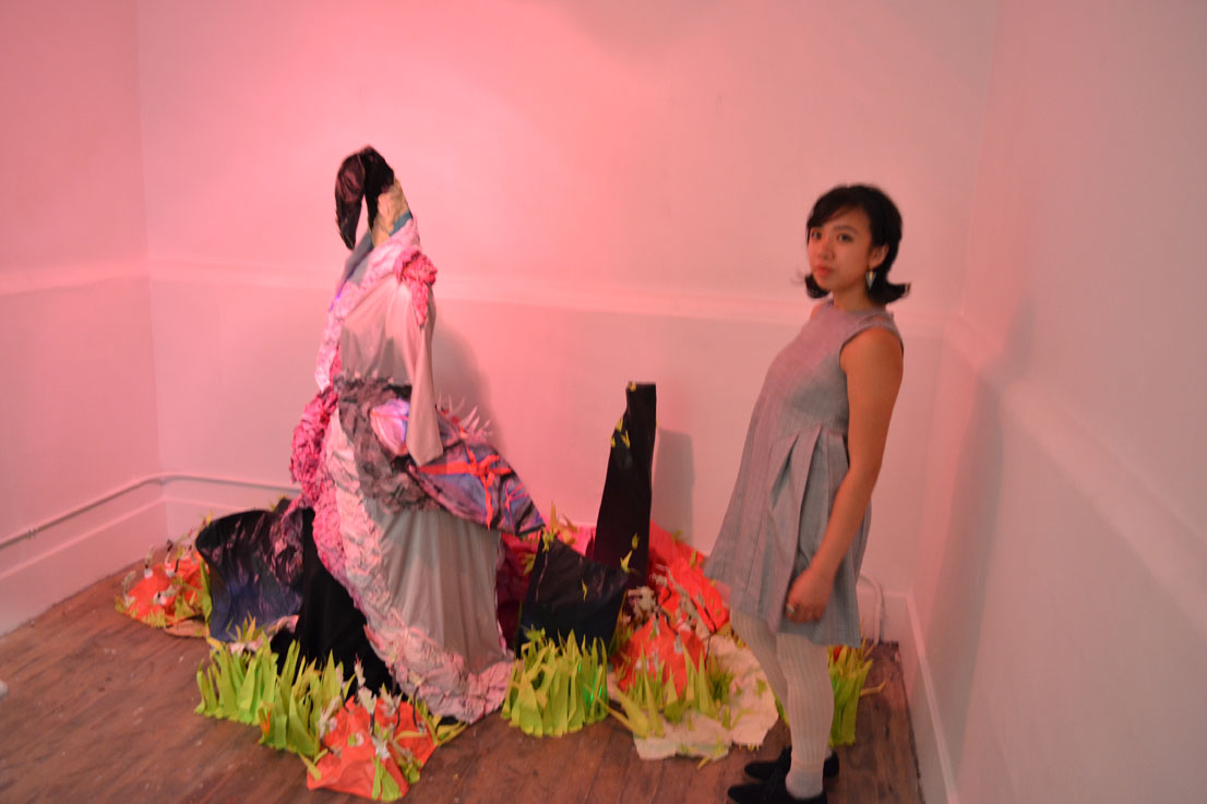 """Robin standing next to her piece at her show """"Mythological Bird"""" August 2014."""