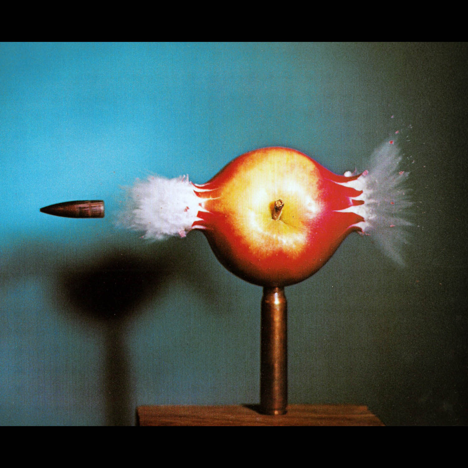 edgerton_bullet through apple.jpg