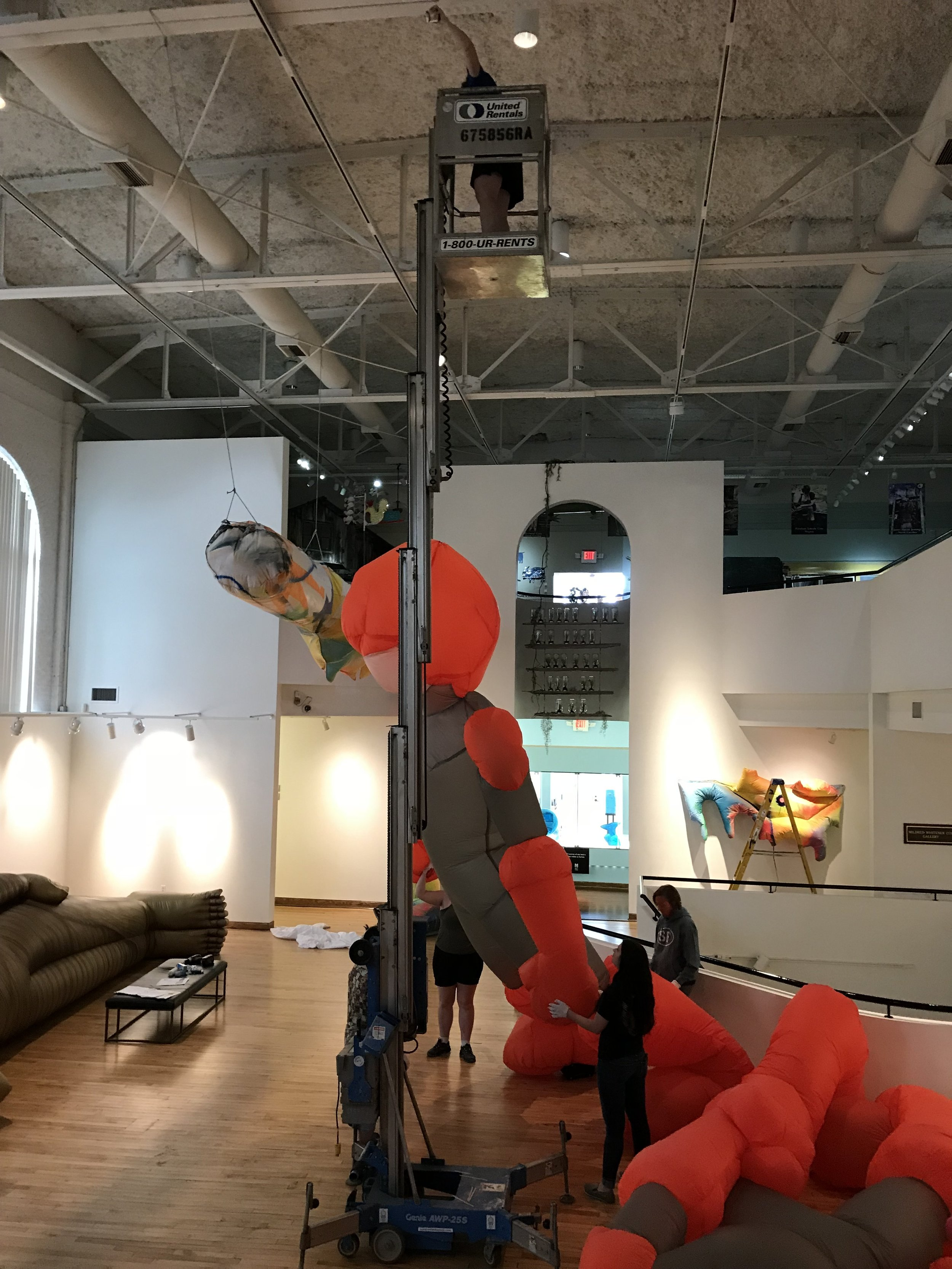 Kristina on lift installing BLOW UP.