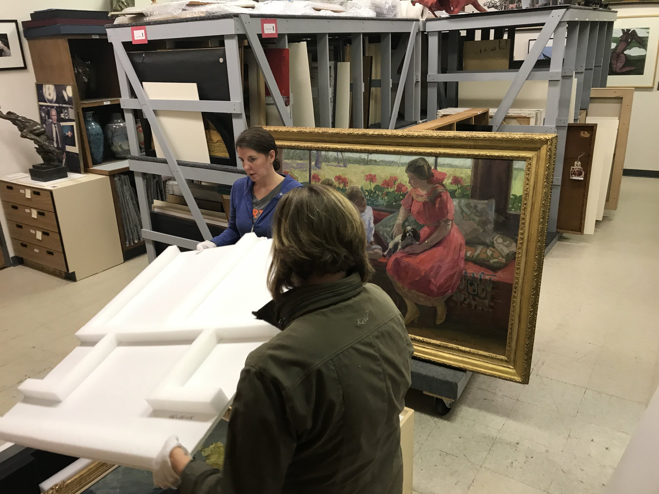 Kristina and Clarissa packing up Jane Petereson paintings for travel.