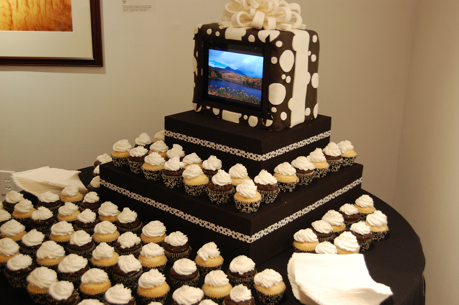 Cake display for Carl Moser's exhibition opening and 90th birthday celebration. The cake had an iPad embedded that scrolled through Moser's work.