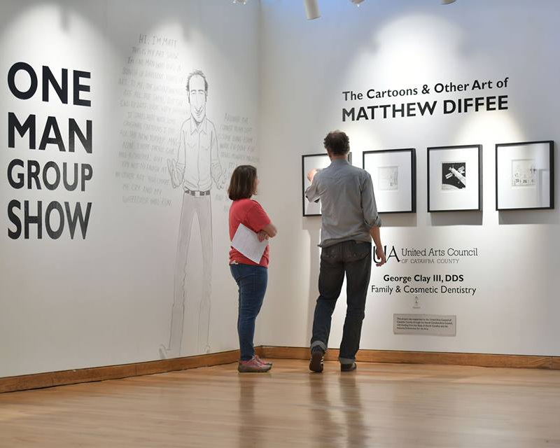 Kristina and Matt Diffee, cartoon artist for The New Yorker, finalize his exhibition. Photo © Jason Overby.