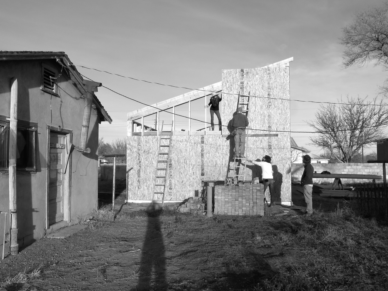 6 January 2015: Lisa (leaning out from our loft), Van (on the ladder), Brandon (supporting the sinking ladder), Josh, and myself (elongated by the evening sun).