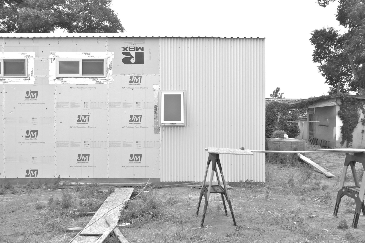 21 May 2015: Three panels of siding on the north wall.