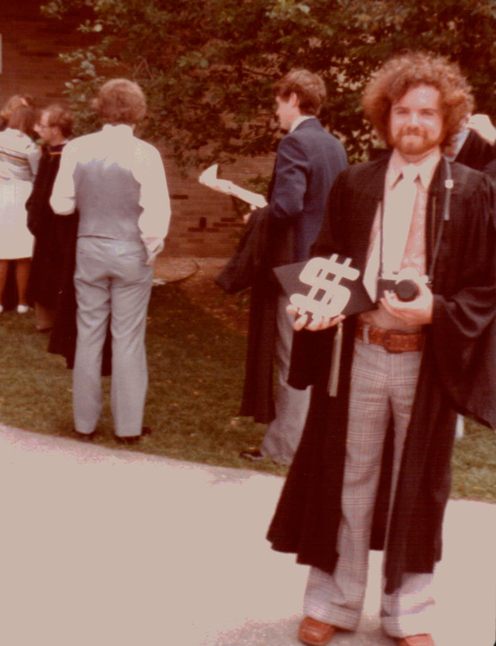 graduation picture of my dad and pesto hummus